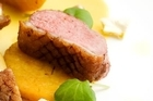 Duck breast with pineapple and watercress. Photo / Babiche Martens