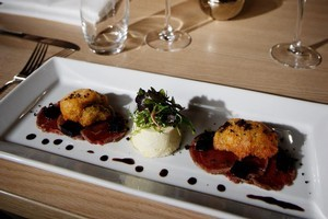 Beef carpaccio, oysters in batter, blue cheese panna cotta and balsamic jelly. Photo / Christine Cornege