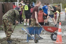 Soldiers help clean up after the Canterbury earthquake. Photo / Mark Mitchell