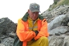 Biodiversity Programme manager Phil Bradfield inspects two seal carcasses. Photo / DOC