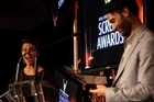 Taika Waititi accepts his award from Kate Rodger. Photo / nzherald.co.nz