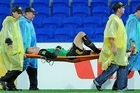 Mark Paston of the Phoenix is stretched off during his side's 2-0 loss to Gold Coast United. Photo / Getty Images