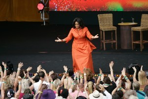 Oprah Winfrey's voluminous dress would have had women's magazine editors reaching for their pens. Photo / AP