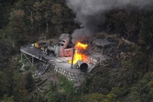 Fire coming from the vent shaft of the Pike River mine, before yesterday's successful capping operation. Photo / NZ Police