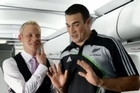 Air NZ steward Will Coxhead and All Black Richard Kahui in the controversial in-flight safety video. Photo / Supplied.