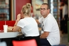 Paul Henry sits at Burger King at Auckland International Airport as he waits to board a plane to Sydney. Photo / Brett Phibbs