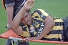 Paul Ifill of the Phoenix is stretchered off of the field injured against the Newcastle Jets. Photo / Getty Images
