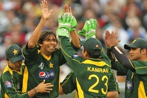 Mohammad Asif, left, won't be touring New Zealand afer being suspended by the ICC. Photo / Getty Images
