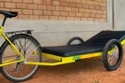 The Zambulance is a bicycle fitted with a trailer that has a mattress, privacy curtain and intravenous hangers. Photo / Supplied