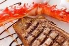 Euro's New York strip steak and king crab claw. Photo / Babiche Martens