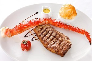 Euro's New York strip steak and king crab claw. Photo / Babiche Martens