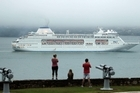 The Pacific Pearl eases its way into Auckland on a misty morning.