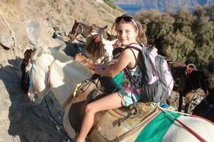 Samantha on a donkey on Santorini. Photo / Jacqui Thomas