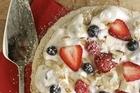 Pavlova with cream and berries. Photo / Janna Dixon