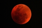 The moon turns red during the 2007 lunar eclipse. Photo / Alan Gibson