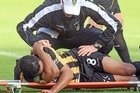 Paul Ifill of the Phoenix is stretchered off of the field injured. Photo / Getty Images