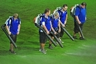 Stadium workers use garden blowers to remove water from the pitch before the North Queensland Fury and Wellington Phoenix match. Photo / Getty Images