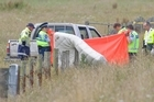 Emergency services at the scene of a crash near Reporoa where a 16-year-old died after the truck he was riding on the back of rolled. Photo / Rotorua Daily Post