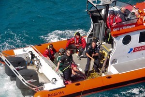 The coastguard take one of the fishermen back to shore. Photo / Westpac Rescue Helicopter
