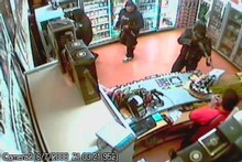 A security camera shows Anitelea Chan Kee pointing a rifle at Navtej Singh. Photo / Supplied