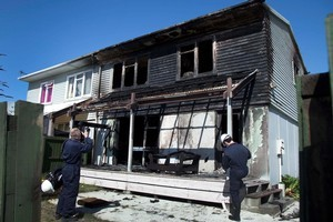 Police at the Christchurch house where Tisha Lowry and Rebecca Chamberlain were killed. Arsonists torched it several times and it was eventually demolished. Photo / Simon Baker