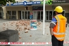 A building inspector checks for damage in rubble-strewn Cathedral Square. Photo / Simon Baker