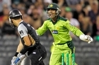 Umar Akmal of Pakistan celebrates as Peter McGlashan is bowled during game three of the Twenty20 series. Photo / Getty Images