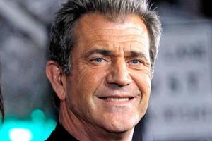 Hollywood star Mel Gibson has been caught calling a reporter an 'a**hole' at the end of a TV interview. Photo / AP