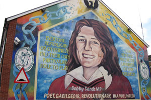 A mural of IRA martyr Bobby Sands dominates a Sinn Fein bookshop. Photo / Graham Reid