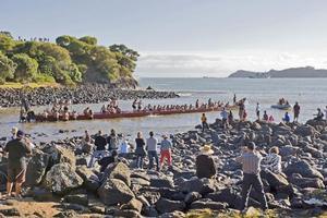 A crew of paddlers board the waka Ngatokimatawhaorua at Waitangi today to take part in a Waka Karakia - its blessing. Photo / NZPA
