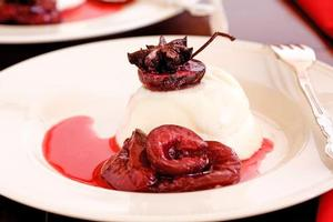 Panna cotta with star anise plums. Photo / Babiche Martens