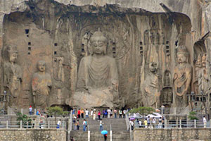 Visitors inspect giant Buddhist statues. Photo / Natalie Gauld