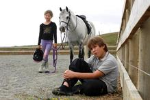 Reilly Webber, pictured with sister Lily, 7, says a neighbour threatened to shoot their pony. Photo / Dean Purcell