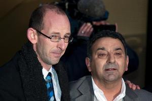 David Bain, flanked by supporter Joe Karam, outside the High Court. Photo / Simon Baker