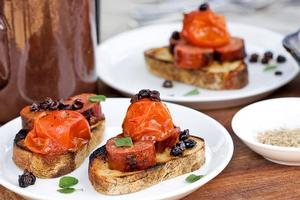 Chorizo, tomatoes, currants and oregano on toast. Photo / Babiche Martens