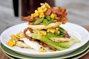 Avocado pikelets, grilled corn, basil and bacon. Photo / Babiche Martens