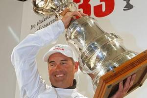 Sir Russell Coutts savours the moment yesterday after BMW Oracle won the America's Cup from Alinghi. Photo / AP