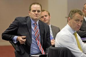 Simon Power (far left), pictured with Mark Weldon, last week urged regulators to up their game. Photo / Mark Mitchell