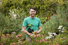 Horticulturist Philip Smith at one of his commissioned gardens in Three Kings. Photo / Babiche Martens