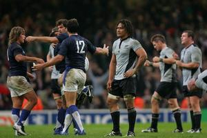 Rodney So'oialo (centre) lets the reality sink in as the French celebrate their 2007 quarterfinal win. Photo / Brett Phibbs