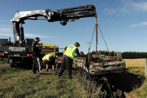Police recover the vehicle at the scene of a fatal crash near Hastings. Photo / NZPA.