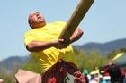 Mick Cottrell tosses the caber. Photo / Northern Advocate.