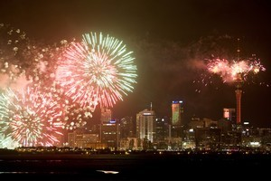 The Auckland skyline is lit up with fireworks to celebrate the arrival of 2011. Photo / Dean Purcell