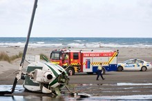 The helicopter wreck at Hokio Beach, near Levin. Photo / NZPA 
