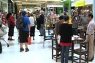 Christchurch locals stand during two minutes silence in a Christchurch mall. Photo / nzherald.co.nz Video