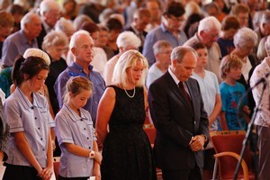 His Worship the Mayor of Auckland Len Brown with his family at the Holy Trinity Cathedral in Auckland. Photo / Richard Robinson