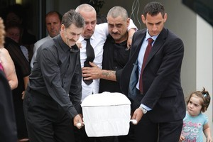Grant Smith is assisted as he walks behind the coffin of his 9-month-old son, Jayden Harris.. Photo / Mark Mitchell