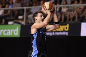 Breakers' star Kirk Penney is airborne against the Townsville Crocs during last night's thriller at North Shore Events Centre. Photo / Natalie Slade