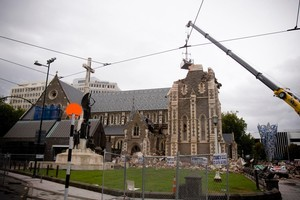 Recovery crews look over the Christchurch Cathedral. Photo / Dean Purcell