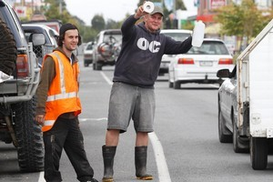 Volunteers hand out free water and toilet paper to motorists in Christchurch. Photo / Mark Mitchell